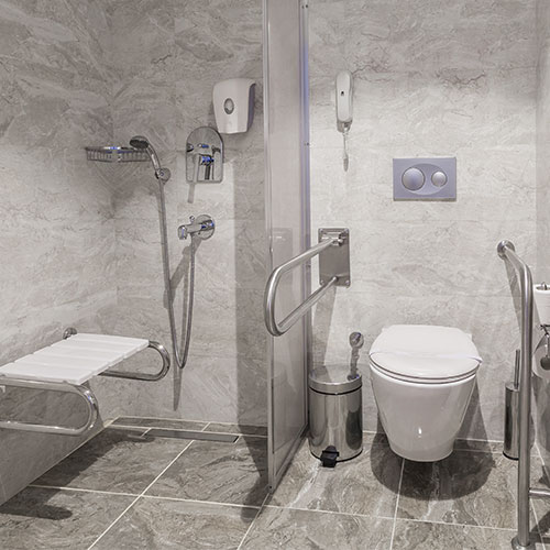 Bathroom with safety grab bars